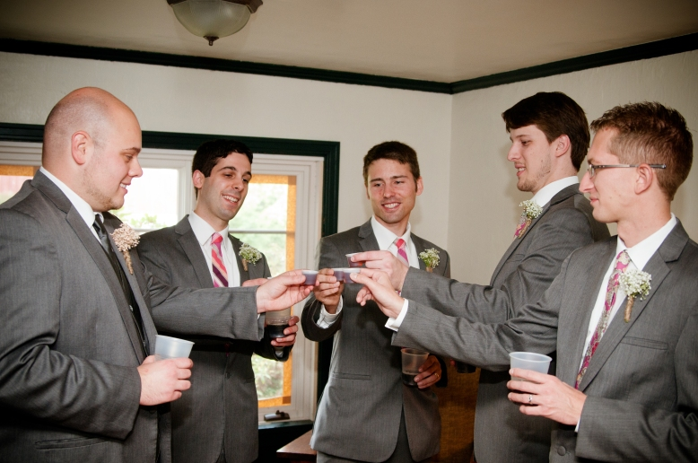 groomsmen toasting photo