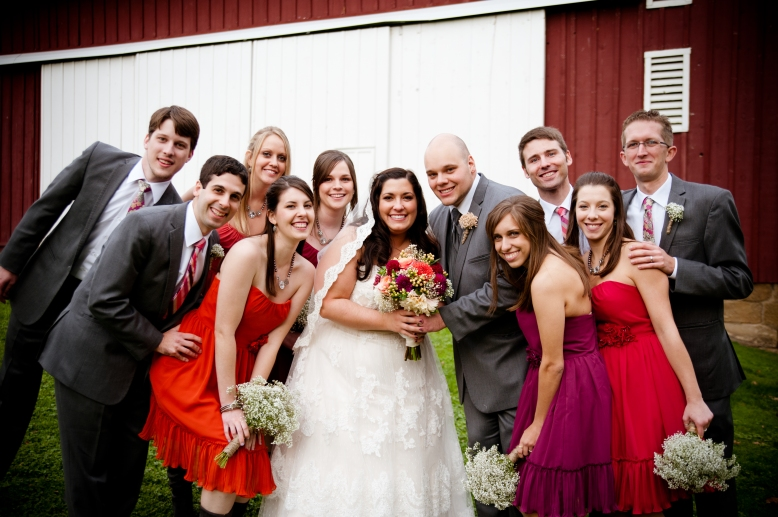 wedding party in front of barn