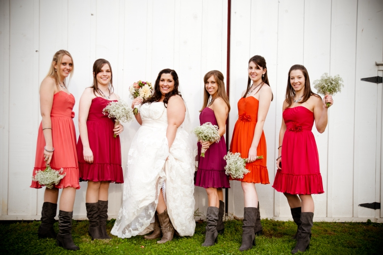 bridesmaids with boots in front of barn