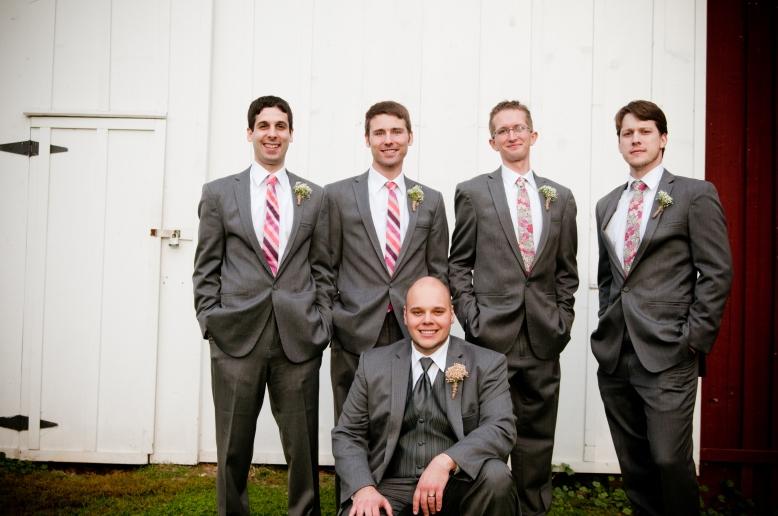 groomsmen in front of barn