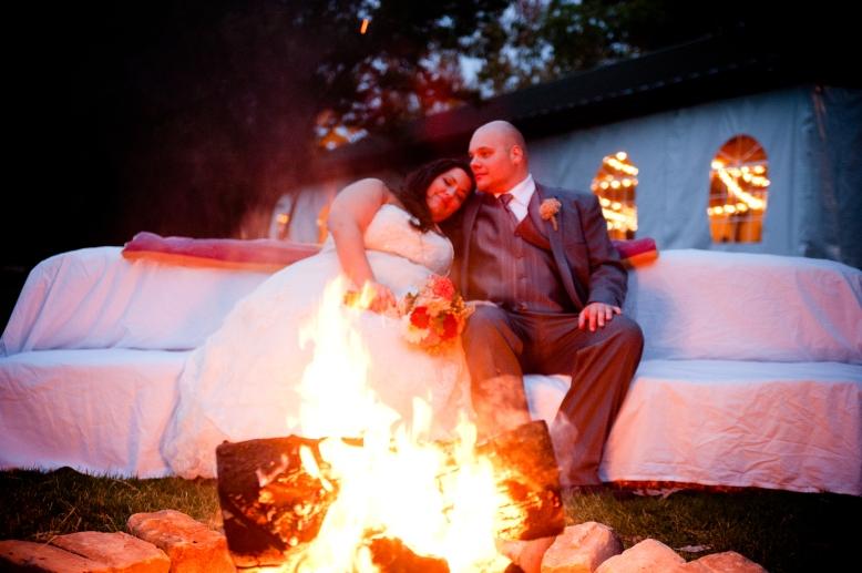 bride groom by campfire