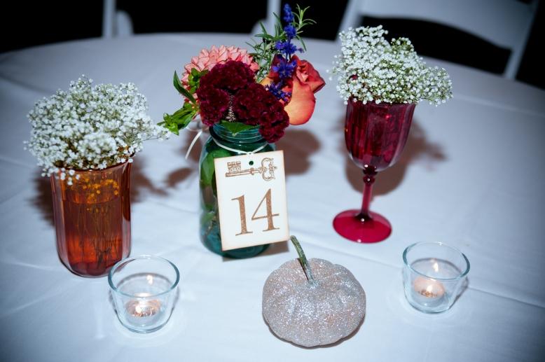 blue-mason-jar-centerpiece-pink-orange-accents-flowers