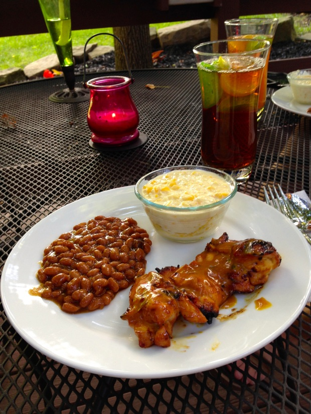 July 4th Picnic Food - Carolina BBQ chicken, southern baked beans, and corn pudding.