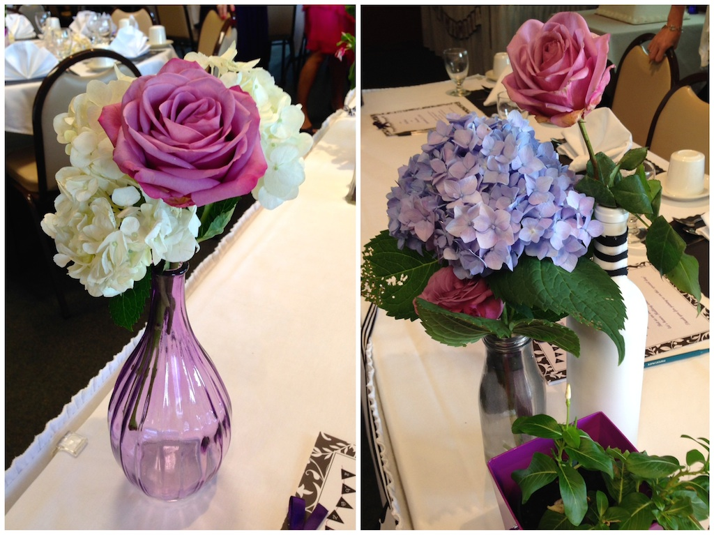 purple bridal shower flowers in glass bottles life is sweet as a peach